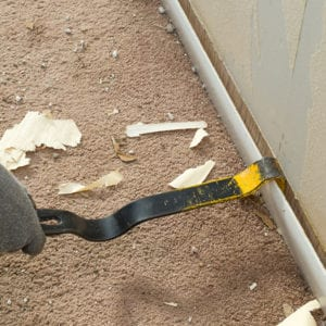 image showing removal of baseboard