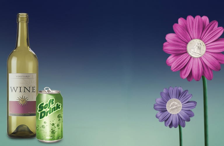 An aluminum can, plastic juice container, glass wine bottle and two flowers that are purple and pink with a silver coin inside the centre of each.