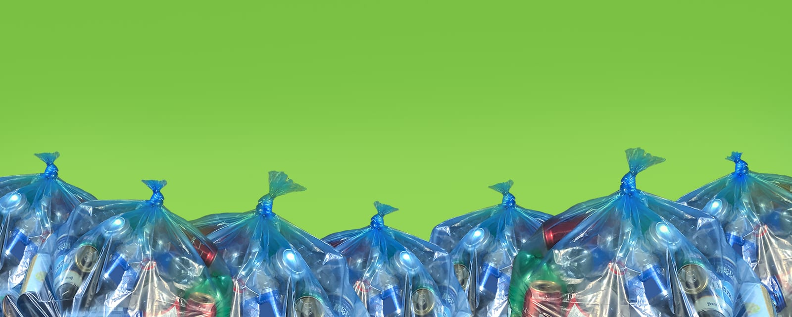 Many blue recycling bags filled with recyclables on a bright green background with the text Green Depots Open For Xpress Only.